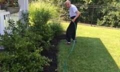 Resident watering flowers